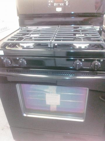 (9) Maytag MGR7665WB 30″ Gas Range with Cast-Iron Continuous Grates, Clock and Window, Black